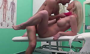 Busty blonde round white-hot scarf bangs doctor